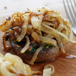 baked field mushrooms with caramelised onions, kale and nettle