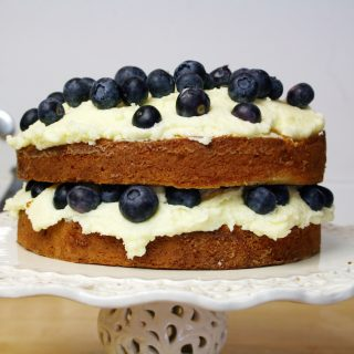 blueberry sour cream and almond cake with whipped double cream butter icing