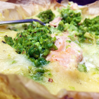 baked cheddar polenta and salmon with crushed pea and garlic