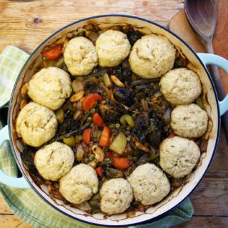 butter bean, pearl barley and kale stew with cheesy herb dumplings