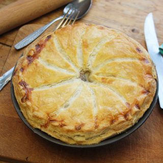 creamy onion, broccoli and mushroom pie with a ruff puff pastry crust